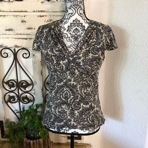 Ann Taylor silk blend black/cream side zip blouse